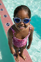 Girl Wearing Goggles on Edge of Swimming Pool