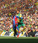 Wayne Hennessey and Nathan Redmond have a good battle during the Barclays Premier League match between Norwich City and Crystal Palace at Carrow Road, Norwich, England on 8 August 2015. Photo by Craig McAllister.