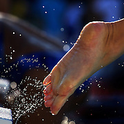 A swimmers feet leave the blocks during early morning warm up before the start of the heats at the World Swimming Championships in Rome on Thursday, July 30, 2009. Photo Tim Clayton.