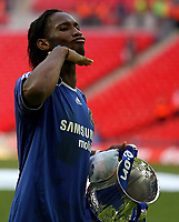 Photo: Paul Thomas.<br /> Chelsea v Manchester United. The FA Cup Final. 19/05/2007.<br /> <br /> Didier Drogba of Chelsea celebrates.