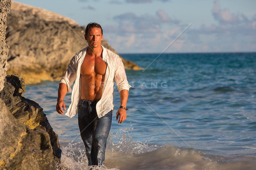 handsome man with an open shirt walking in ocean, Bermuda