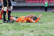 23.04.2010, Ratina, Tampere..Veikkausliiga 2010, Tampere United - JJK Jyv?skyl?..JJK:n Antto Tapaninen vaikeroi nurmen pinnassa..©Juha Tamminen.