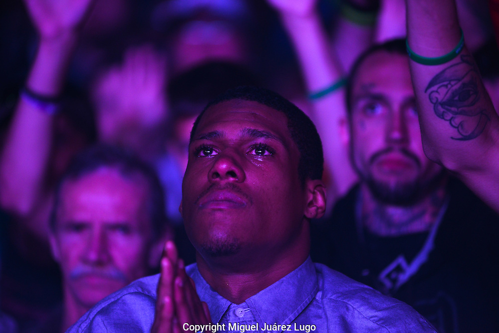 Montezz Williams, 25, prays during an emotional concert for heroin addicts put on by two pastors from the Cincinnati area. Their band, Livestock, uses music and an emotional religious message to reach addicts who have often tried and failed at rehab. Williams, of Dayton, said he has been sober 40 days so far after being addicted to heroin for four years.