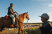 Frank Archambault returns to his camp to greet his grandson after a day of scouting the pipeline pathway on horseback near Cannon Ball, North Dakota, U.S. Archambault played the role of a scout, riding daily into the hills surrounding the encampment of protestors gathered to fight the Dakota Access Pipeline.