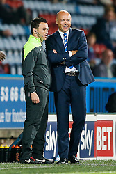 Manager Uwe Rosler of Wigan jokes with the 4th official - Photo mandatory by-line: Rogan Thomson/JMP - 07966 386802 - 16/09/2014 - SPORT - FOOTBALL - Huddersfield, England - The John Smith's Stadium - Huddersfield Town v Wigan Athletic - Sky Bet Championship.
