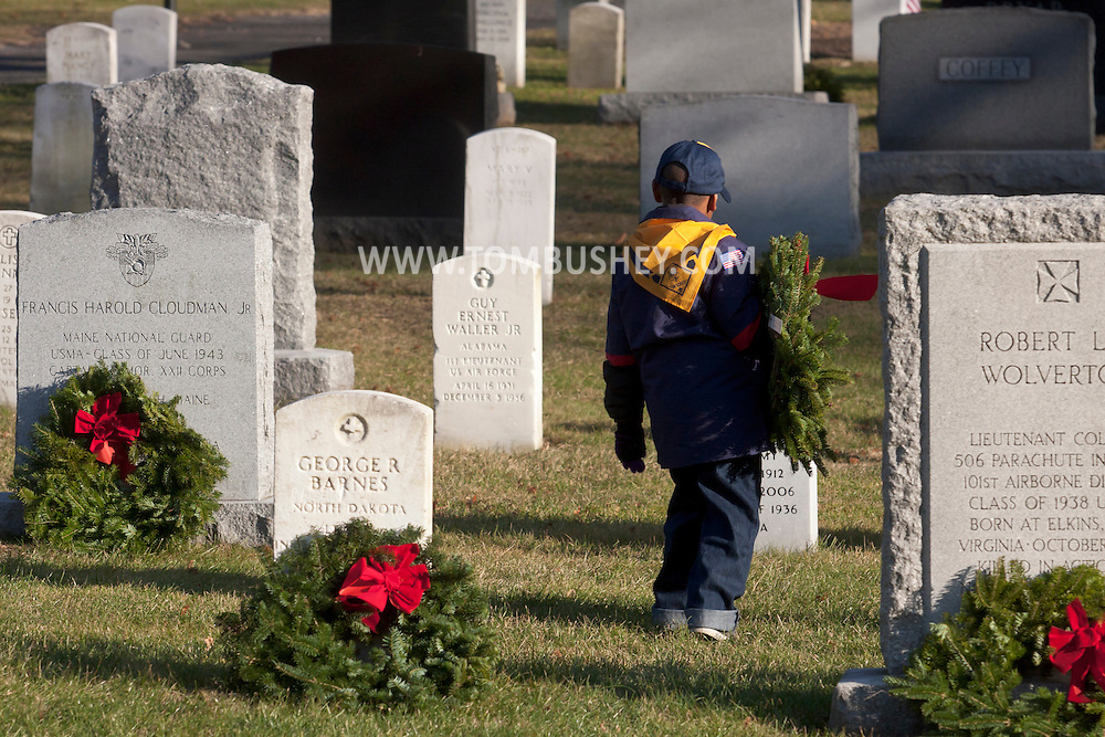 West Point, New York - The fourth annual West Point and Wreaths Across America ceremony was held the West Point Cemetery at the United States Military Academy on Dec. 7, 2013. Volunteers placed 2074 wreaths at graves in the cemetery.