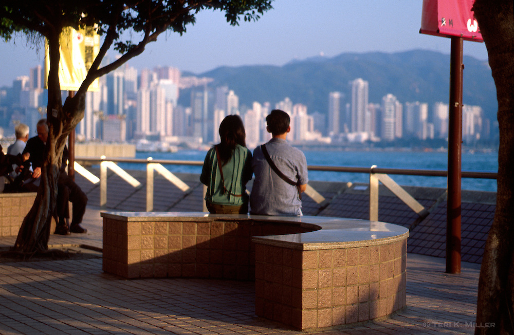 A couple shares a quiet moment on the Promenade in Kowloon, Hong Kong, China.