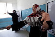 Egyptians  women as for assistance as they vote at a polling station in the El Mokattam neighborhood of  Cairo , Egypt May 23, 2012. Egyptians head to the polling stations throughout Egypt  Wednesday for an historic opportunity in which they will for the first time to pick their president in a wide open election that pits Islamists against men who served under deposed leader Hosni Mubarak.(Photo by Heidi Levine/Sipa Press).