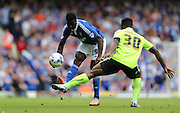 Ipswich Town defender Josh Emmanuel knocks the ball past Brighton midfielder, winger, Kazenga LuaLua during the Sky Bet Championship match between Ipswich Town and Brighton and Hove Albion at Portman Road, Ipswich, England on 29 August 2015.