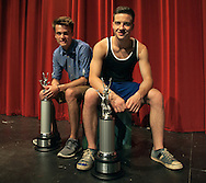 Jordan Hartjen, left, and Matt Wisenden recently returned home from the national speech tournament in Kansas City, Mo., where they took first place in the duo interpretation category. The two are seen here with their championship trophies Wednesday, June 25, 2014, at Moorhead High School in Moorhead, Minn.<br /> Nick Wagner / The Forum