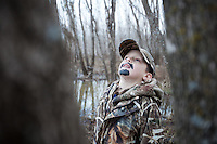 YOUNG BOY DUCK HUNTER WEARING REALTREE MAX 4 CAMOUFLAGE  WITH HIS FACE PAINTED