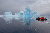 "Zodiac among the incredible ice formations in the ""iceberg graveyard"" at Port Charcot in the Wilhelm Archipelago of Antarctica."