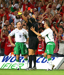CARDIFF, WALES - Wednesday, September 8, 2004: Northern Ireland's Michael Hughes is shown the red card and sent off by referee Domenico Messina after clashing with Wales' Robbie Savage during the Group Six World Cup Qualifier at the Millennium Stadium. (Pic by David Rawcliffe/Propaganda)