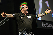 Peter Wright takes to the stage during the Premier League Darts  at the Motorpoint Arena, Cardiff, Wales on 31 March 2016. Photo by Shane Healey.