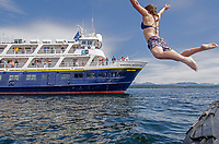 Polar plunge by the National Geographic Sea Bird in Pavlof Harbor on Chichagof Island, Southeast Alaska.