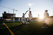 MADISON, WI -AUG. 20, 2015: Daiki Furikado of Japan's Buzz Bullets jumps to block a pass while warming up with Nobuyuki Sugaya. The Madison Radicals compete against Japan's Buzz Bullets in a post-season exhibition ultimate frisbee game at Breese Stadium in Madison, Wisconsin Thursday, August 20, 2015. The Radical's defeat the Buzz Bullets 28-21. Lauren Justice for The New York Times
