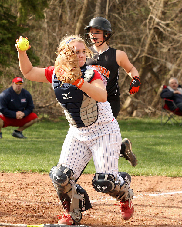 Southwestern's catcher Summer Borysoff makes a throw to first during softball action against Fredonia 4-15-13 photo by Mark L. Anderson