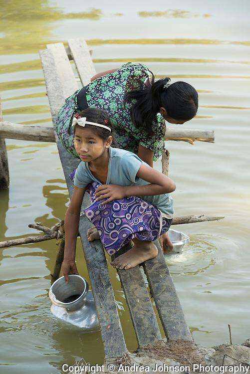Girls collecting drinking water from lake, Mrauk U, Burma