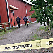Ian Stewart/Yukon News<br /> CRIME SCENE... RCMP investigate a homocide on Monday morning on the banks of the Yukon River in downtown Whitehorse. Few details are available.