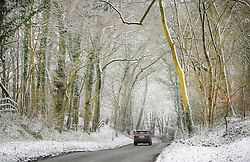© Licensed to London News Pictures. 12/02/2017. Princess Risborough, UK. A car drives through a snow covered landscape in Princess Risborough, Buckinghamshire, south east England, as large parts of the UK wake to freezing temperatures and snowfall over night. Photo credit: Ben Cawthra/LNP