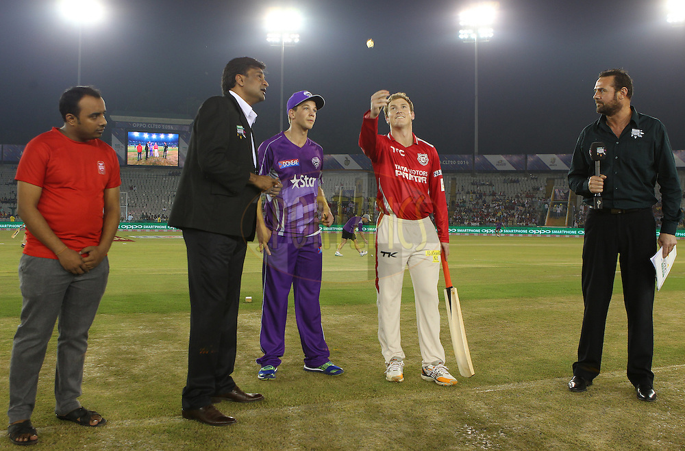 Tim PAINE (Captain) of the Hobart Hurricanes  and George BAILEY (Captain) of the Kings XI Punjab  at the toss during match 2 of the Oppo Champions League Twenty20 between the Kings XI Punjab and the Hobart Hurricanes held at the Punjab Cricket Association Stadium, Mohali, India on the 18th September 2014<br /> <br /> Photo by:  Ron Gaunt / Sportzpics/ CLT20<br /> <br /> <br /> Image use is subject to the terms and conditions as laid out by the BCCI/ CLT20.  The terms and conditions can be downloaded here:<br /> <br /> http://sportzpics.photoshelter.com/gallery/CLT20-Image-Terms-and-Conditions-2014/G0000IfNJn535VPU/C0000QhhKadWcjYs