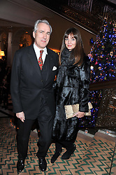 JEREMY KING and LAUREN GURVICH at the unveiling of the Claridge's Christmas tree 2011 designed by Alber Elbaz for Lanvin held at Claridge's, Brook Street, London on 5th December 2011.