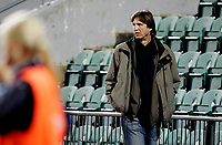 Football<br /> Champions League<br /> Nadderud Stadion 28.09.11<br /> Stabæk - FFC Frankfurt<br /> Former Olympic champion in High-jump , and fellow German , Dietmar Mögenburg watches the game from the track behind the benches . <br /> Foto: Eirik Førde