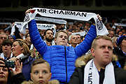 Fans hold up scarves during the tribute before the Premier League match between Leicester City and Burnley at the King Power Stadium, Leicester, England on 10 November 2018.