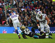 Buffalo Bills LeSean McCoy getting tackled by Jacksonville Jaguars Telvin Smith during the Buffalo Bills v Jacksonville Jaguars NFL International Series match at Wembley Stadium, London, England on 25 October 2015. Photo by Matthew Redman.