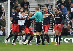 Reading's Daniel Williams (centre) pleads with the referee Craig Pawson for a penalty.- Photo mandatory by-line: Alex James/JMP - Mobile: 07966 386802 - 14/02/2015 - SPORT - Football - Derby  - ipro stadium - Derby County v Reading - FA Cup - Fifth Round