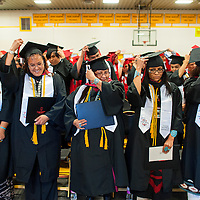 121213       Brian Leddy<br /> Navajo Technical University students move their tassels from one side to the other during graduation ceremonies in Chinle Friday. The school celebrated it's first graduation ceremonies as a university this week.
