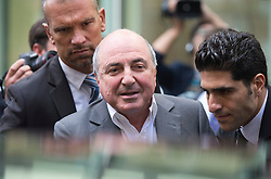 © London News Pictures. 31/08/2012. London, UK. Russian Oligarch Boris Berezovsky leaving The Royal Courts Of Justice escorted by security on August 31, 2012 after a judge ruled against Berezovsky in a  £3.2 billion lawsuit over Abramovich's £10.3 billion fortune. Photo credit: Ben Cawthra/LNP