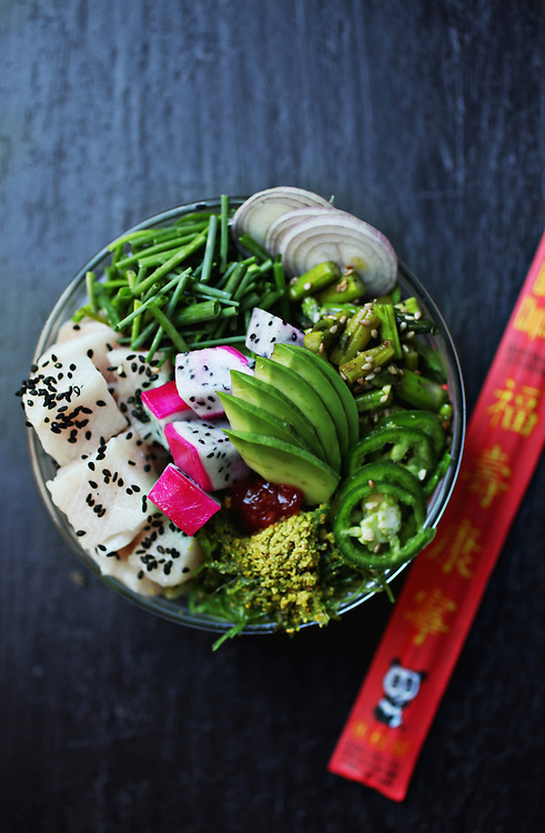 The Hustle, made up of chive, dragonfruit, jalapeno, pistachio dust, sesame asparagus, seaweed salad, shallot, chef's mix microgreens and tuna, is one of several pokés available at Raleigh Raw in downtown Raleigh.