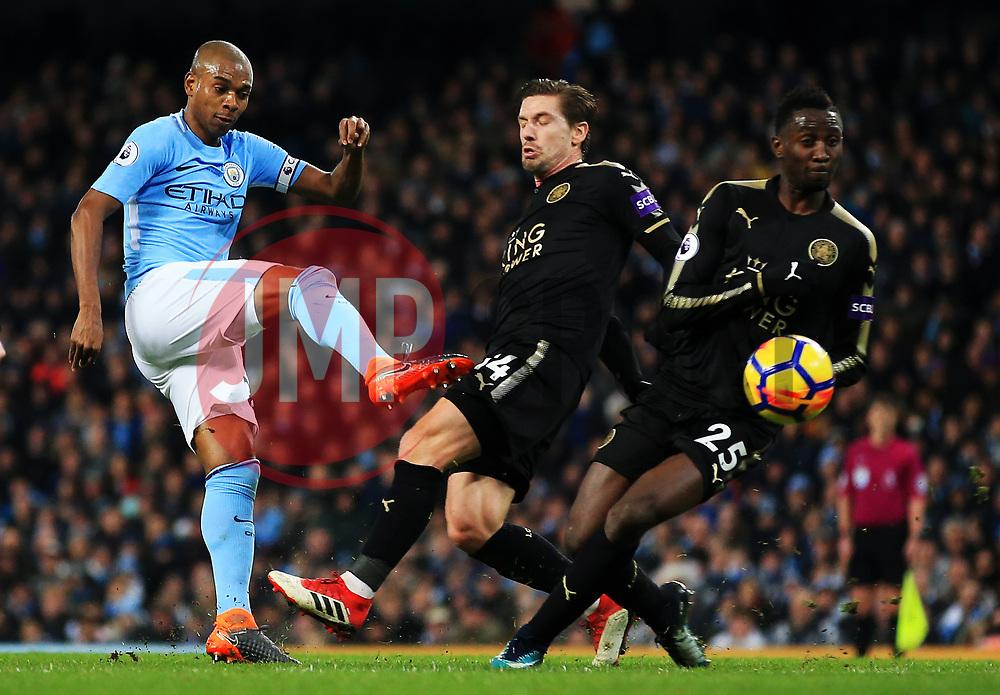 Fernandinho of Manchester City fires a shot at goal under pressure from Adrien Silva of Leicester City - Mandatory by-line: Matt McNulty/JMP - 10/02/2018 - FOOTBALL - Etihad Stadium - Manchester, England - Manchester City v Leicester City - Premier League