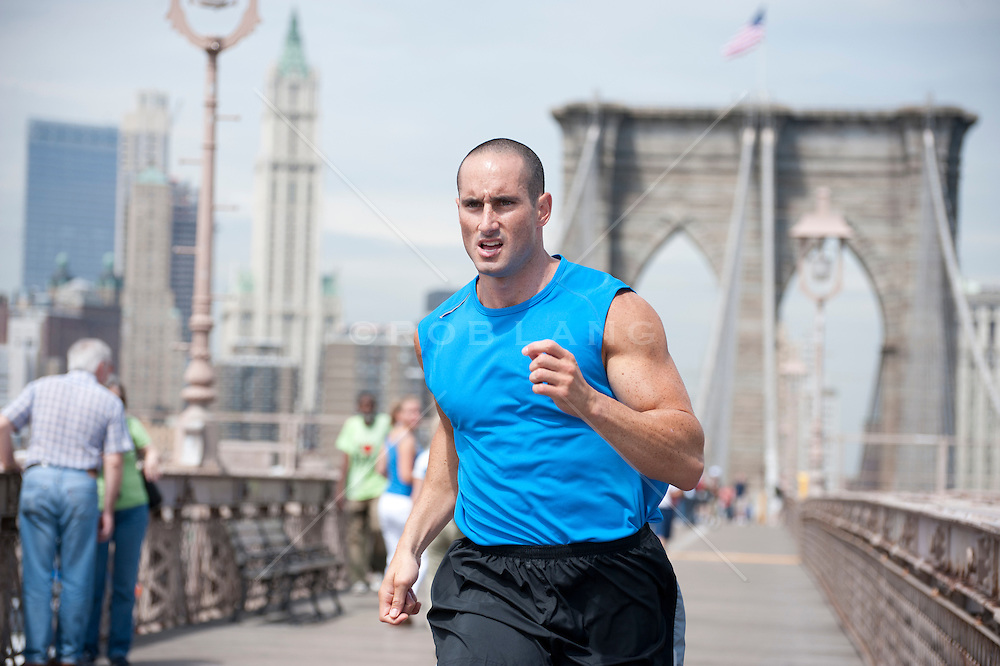 man jogging on the Brooklyn Bridge in New York City