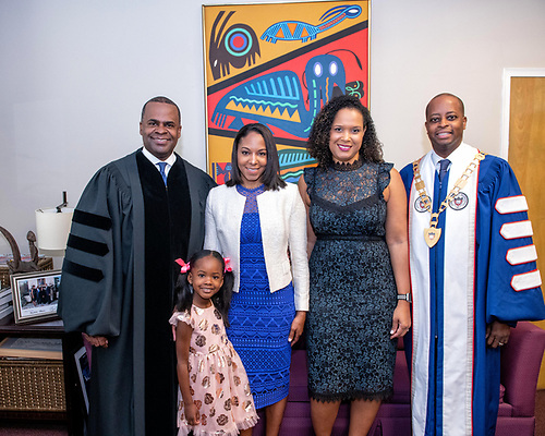 Kasim Reed, Mrs. Reed, and their daughter alongside University President Wayne A.I. Frederick and the First Lady.