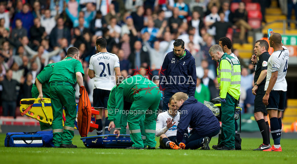 LIVERPOOL, ENGLAND - Sunday, March 30, 2014: Tottenham Hotspur's Nabil Bentaleb is carried off injured during the Premiership match against Liverpool at Anfield. (Pic by David Rawcliffe/Propaganda)