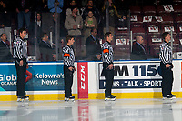 KELOWNA, BC - SEPTEMBER 28:  Linesmen Riley Balson and Dustin Minty line up with referees Matt Hicketts and Steve Papp at the Kelowna Rockets against the Everett Silvertips  at Prospera Place on September 28, 2019 in Kelowna, Canada. (Photo by Marissa Baecker/Shoot the Breeze)