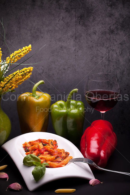 Still life of typical Italian cuisine - Penne Rigate Con Peperoni (Penne With Peppers).
