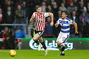 Brentford defender Chris Mepham (6) and QPR midfielder Massimo Luongo (21) during the EFL Sky Bet Championship match between Queens Park Rangers and Brentford at the Loftus Road Stadium, London, England on 10 November 2018.