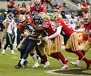 Nov 26, 2017; Santa Clara, CA, USA; Seattle Seahawks running back Eddie Lacy (27) is gang tackled in the first quarter against the San Francisco 49ers at Levi's Stadium.  Seattle beat San Francisco 24-13.