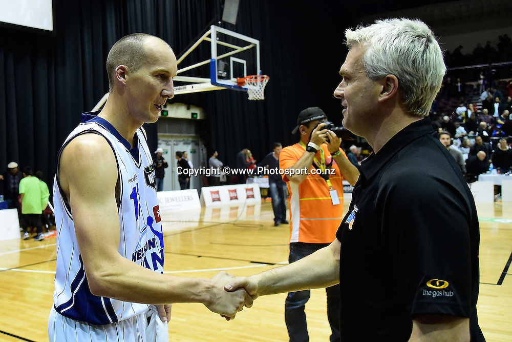 Phill Jones (L) of the Giants shakes hands with Shane Heal head coach of the Saints after his last game during a NBL - Saints vs Giants semi final four basketball match at the TSB Arena in Wellington on Friday the 4th of July 2014. Photo by Marty Melville/www.Photosport.co.nz