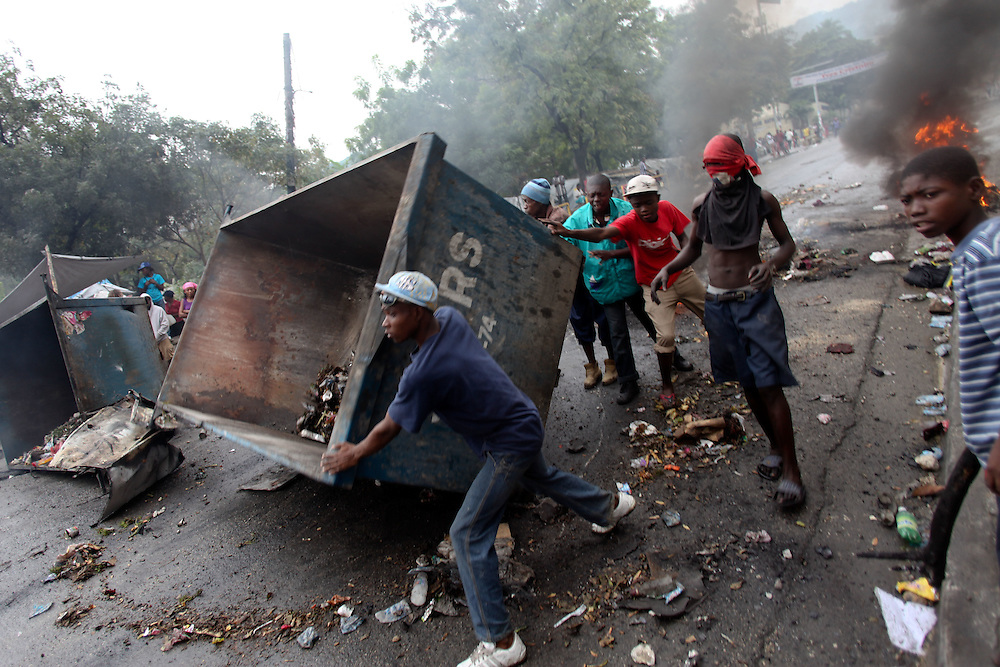 Protestors build a roadblock. Protesters are taking to the streets for the second day in a row in response to Haiti's election results which were announced on Tuesday December 7th among allegations of fraud.