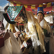 Bagston &ndash; A Ladakhi Buddhist Wedding. Ladakhi women wear an attractive headgear called Perak, made of black lamb skin studded with semi-precious turquoise stones, covering the head like a cobra&rsquo;s hood and tapering to a thin tail reaching down the back. For ceremonial purposes, colorful robes in silk and brocade are worn. The village people come to celebrate and witness the union by adorning the couple and their immediate relatives with the sacred scarf, the Kathak as a symbolic gesture saying &ldquo;We are witnesses to your marriage&rdquo;. <br /> Ladakh, 2008
