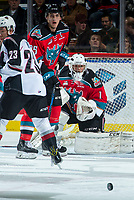 KELOWNA, CANADA - NOVEMBER 10: Cal Foote #25 and  James Porter #1 of the Kelowna Rockets keep their eye on the puck during first period against the Vancouver Giants on November 10, 2017 at Prospera Place in Kelowna, British Columbia, Canada.  (Photo by Marissa Baecker/Shoot the Breeze)  *** Local Caption ***