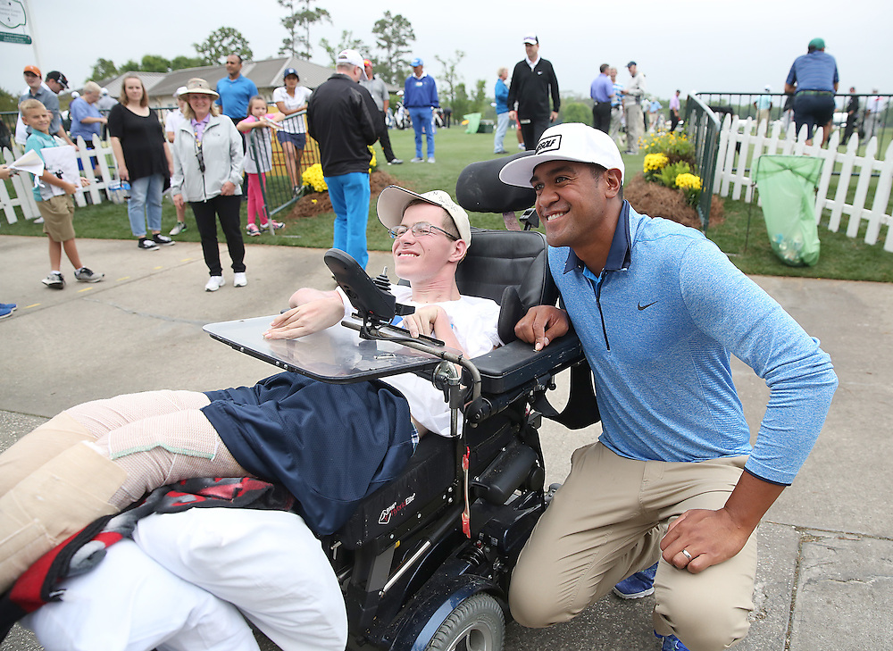 PGA golfer Tony Finau poses with Gary Lynn, age 23 from Houston at the Golf Club of Houston on Tuesday, March 29, 2016 in Humble, TX. (Photo: Thomas B. Shea/For the Chronicle)