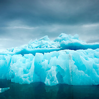 Norway, Svalbard, Spitsbergen Island, Melting ice face of iceberg calved from glacier in Woodfjorden on summer afternoon