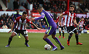 Charlton Athletic midfielder and captain, Jordan Cousins (8) taking on Brentford defender, Nico Yennaris (28) during the Sky Bet Championship match between Brentford and Charlton Athletic at Griffin Park, London, England on 5 March 2016. Photo by Matthew Redman.