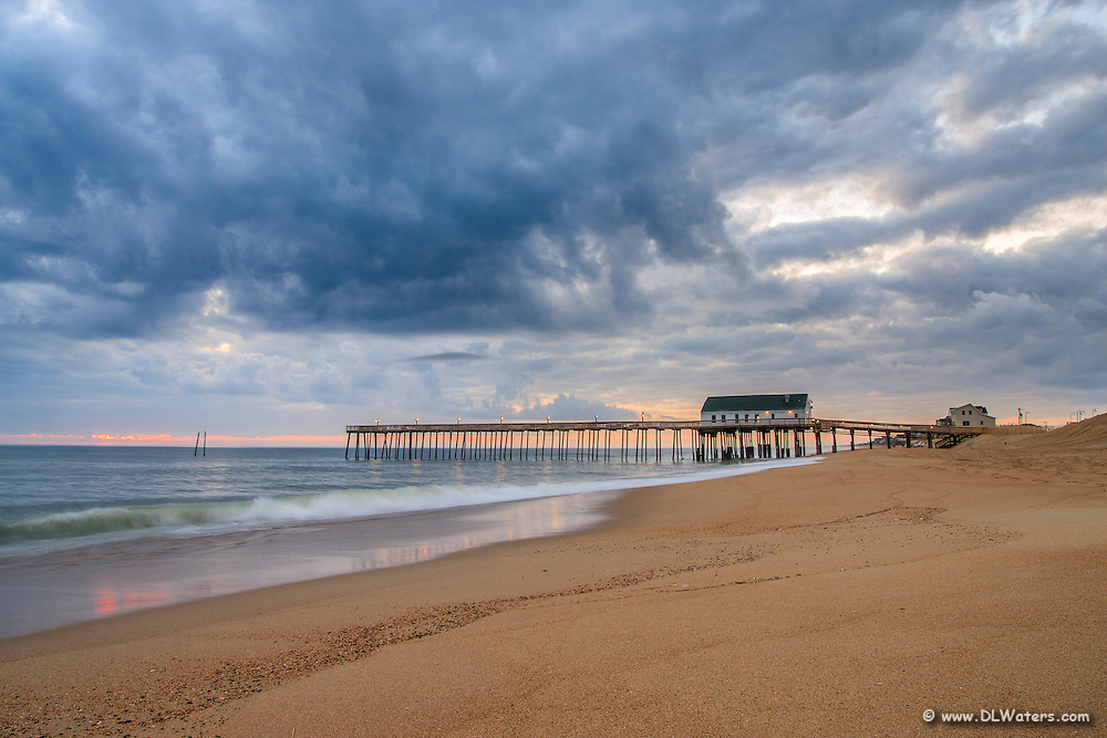 Blue storm clouds at Kitty Hawk pier in the early morning.