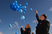 John and Alicia Bennett release balloons with inscriptions written on them to their son, Tommy, 4, at the Sunset View Cemetery in Jackson, CA Tuesday. Tommy died last week while undergoing treatment for Sanfilippo syndrome at Duke University in Durham, North Carolina. About 120 people attended the service at Ione community United Methodist Church in Ione, CA. Tommy's two siblings also have the rare genetic disease. December 2, 2003.